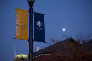 Graduate School banner in the moonlight